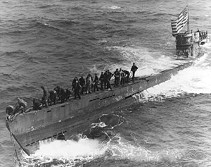 A U.S. Navy boarding party working to secure a tow line to the bow of the captured German submarine U-505, 4 June 1944 (80-G-49172).jpg