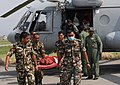A casualty brought from Charikot being de-boarded at Kathmandu from an Indian Air Force (IAF) MI-17 V5 helicopter post a recent massive earthquake which occurred in Nepal on May 19, 2015.jpg