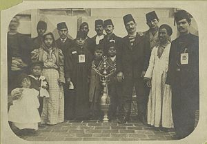 Islam in the United States - A group of immigrants, most wearing fezzes, surrounding a large vessel which is decorated with the star and crescent symbol of Islam and the Ottoman Turks (1902–1913)