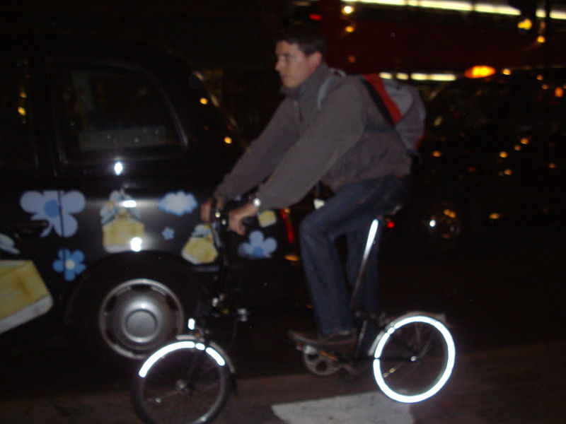 File:A london cyclist in peak 'Friday Night' traffic in 'west end' of London..jpg