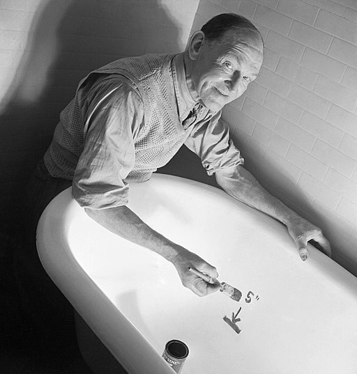 A man draws a line in his bath as part of a British Government's drive to encourage the public to ration their use of hot water and conserve fuel supplies during the Second World War. D11080