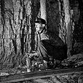 A miner detonates a stick of dynamite.jpg