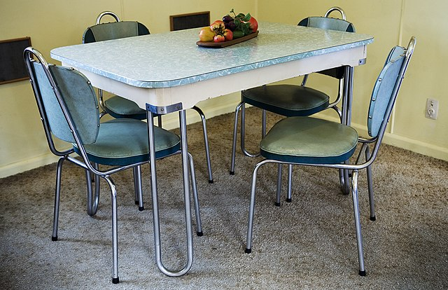 FileA modern dinner set table and chairs in a beach house