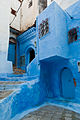 A view of one of the many blue-painted streets in Chefchaouen, Morocco.jpg