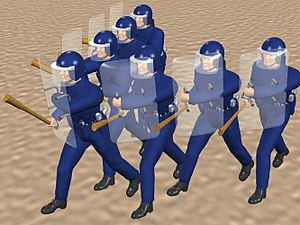 Flying wedge - CGI image of 7 men in riot gear charging in flying wedge.