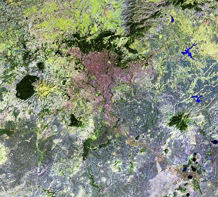 Addis-Ababa and vicinities (false colors satellite image): it is an urbanization strip connecting Addis Ababa and Debre Zeyit city (at image right bottom corner) Addis-Ababa and vicinities, Ethiopia, LandSat-5 false color satellite image, 2011-01-10.jpg