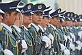 Afghan National Police (ANP) stand in formation while designated visitors arrive (4407170394).jpg