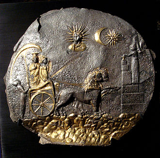 Cybele - Cybele drawn in her chariot by lions towards a votive sacrifice (right). Above are the Sun God and heavenly objects. Plaque from Ai Khanoum, Bactria (Afghanistan), 2nd century BC. Gilded silver, φ 25 cm
