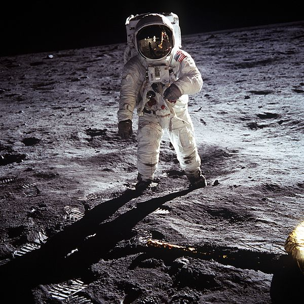 Buzz Aldrin on the Moon, with Neil Armstrong, the U.S. flag, and the Eagle Lunar Module reflected in his helmet visor, July 21, 1969 - NASA photo via Wikimedia