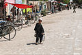 An Afghan boy carries chai tea to store owners along the main road that hosts a bazaar in Mir village, Andar district, Ghazni province, Afghanistan, May 27, 2013 130527-A-TB205-103.jpg