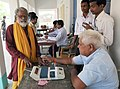 An old man voter being administered indelible ink, at a polling booth, during the 8th Phase of General Elections-2014, in Chhapra, Bihar on May 07, 2014.jpg