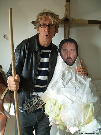 Andy Dick - Dick holding a piñata with a cutout of Tom Green for The 1 Second Film in December 2004