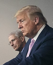 Anthony Fauci and Donald Trump in April 1, 2020 face detail, from- White House Coronavirus Update Briefing (49728735392) (cropped).jpg