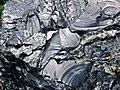 Aphyric rhyolitic obsidian (Roaring Mountain Member, Plateau Rhyolite, Upper Pleistocene, ~59 ka; Obsidian Cliff, Yellowstone, Wyoming, USA) 3 (45894540795).jpg