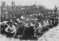At the United Nations' prisoner-of-war camp at Pusan, prisoners are assembled in one of the camp compounds. The camp... - NARA - 541956.tif