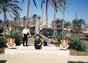 Lady Be Good (aircraft) - Memorial at Wheelus AFB circa 1967 Maj. Don Schmenk seated, Bob Fitzsimmons (L) and Ron Green (R)