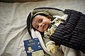 Baby with completed vaccine card (9295966469).jpg