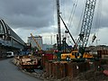 Back-side of Amsterdam Central station with earthwork constructions for the new bus station, photo 2006.jpg