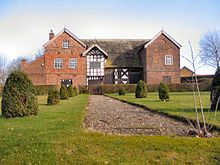 The 14th-century Baguley Hall, in Baguley is also a Grade I listed building Baguley Hall.jpg