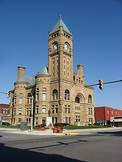 Old courthouse featuring clock tower and turrets