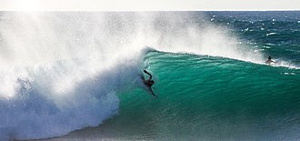 Bodysurfing - Travis Overley bodysurfing at Banzai Pipeline. Shot by Rachel Newton