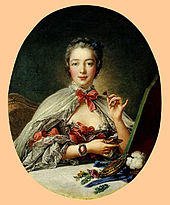 Oval portrait of an elegant woman in a low-bosomed dess, wearing a cloak tied at the neck with a ribbon. She is holding a small flower in her left hand.