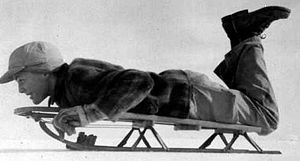 English: Boy on snow sled