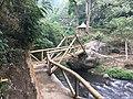Bridge leading to the Coban Pelangi Waterfall.jpg