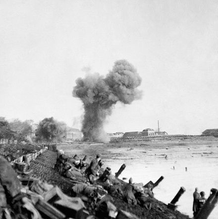 British assault troops advancing near Flushing with shells bursting ahead during the Scheldt operation. British Landings on Walcheren BU1255.jpg