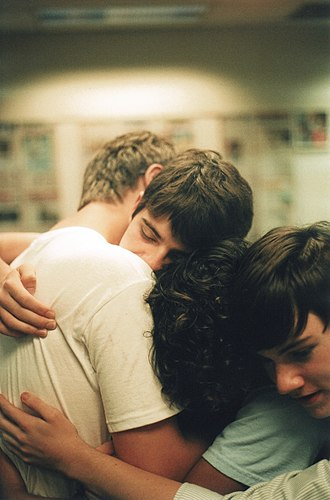 Hug - A group hug among young men, showing their close friendship