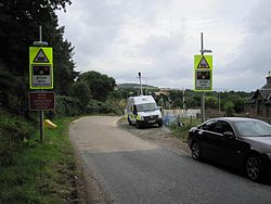 Bunchrew Level Crossing with new barriers (9569315595).jpg