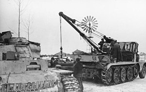 Sd.Kfz. 9 - A Sd.Kfz. 9/1 hoisting a Maybach HL 120 TRM engine into a Panzer III