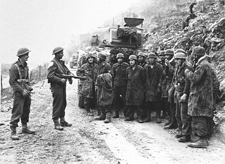 German prisoners captured by New Zealand troops are held beside a Sherman tank. After repeated unsuccessful assaults, the Allied offensive was again called off on 22 March. Bundesarchiv Bild 146-1975-014-31, Monte Cassino, deutsche Kriegsgefangene.jpg