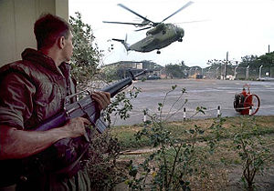 Fall of Saigon - A U.S. Marine provides security as American helicopters land at the DAO compound.
