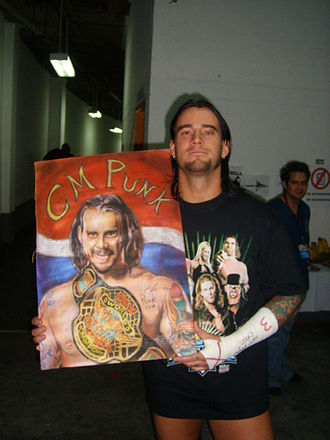 CM Punk - Punk with a portrait as ECW Champion in 2008