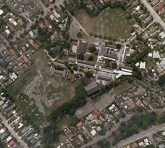 Cashmere High School - Aerial photo of Cashmere High School taken on 24 February 2011, two days after the 2011 Christchurch earthquake. Soil liquefaction can be clearly seen on the playing fields.
