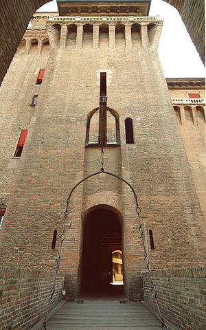 Castello Estense - The western drawbridge. The tower features corbels near the top.