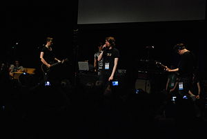 Charlie McDonnell - McDonnell performing with Chameleon Circuit at VidCon 2011.