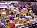 Cheese stall at Barcelona market (2925478944).jpg