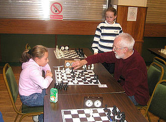 Chess club - Young and old playing in a chess club