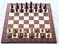 Chess board with chess set in opening position 2012 PD 03.jpg
