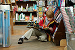 150px Child reading at Brookline Booksmith Pettie Short Fashionable Quineanera Gown 10317