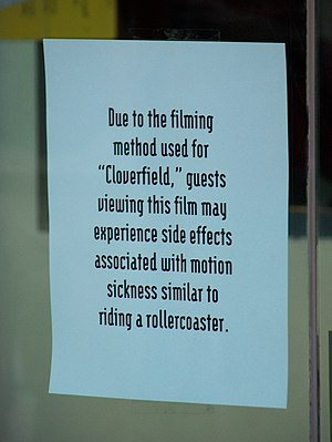 Shaky camera - Sign at an AMC theater warning customers about side effects relating to motion sickness due to the shaky camera technique being used in Cloverfield.