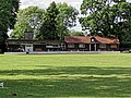 Cockfosters Cricket Club pavilion clubhouse in Cockfosters, London, England.jpg