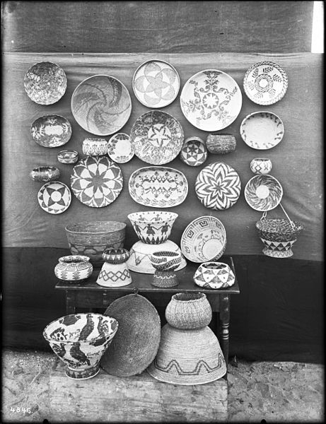 File:Collection of 34 Indian baskets displayed against and in front of a cloth backdrop, ca.1900 (CHS-4846).jpg