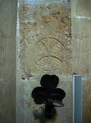 Consecration crosses - Cross with candle sconce in Coimbra Cathedral, Portugal