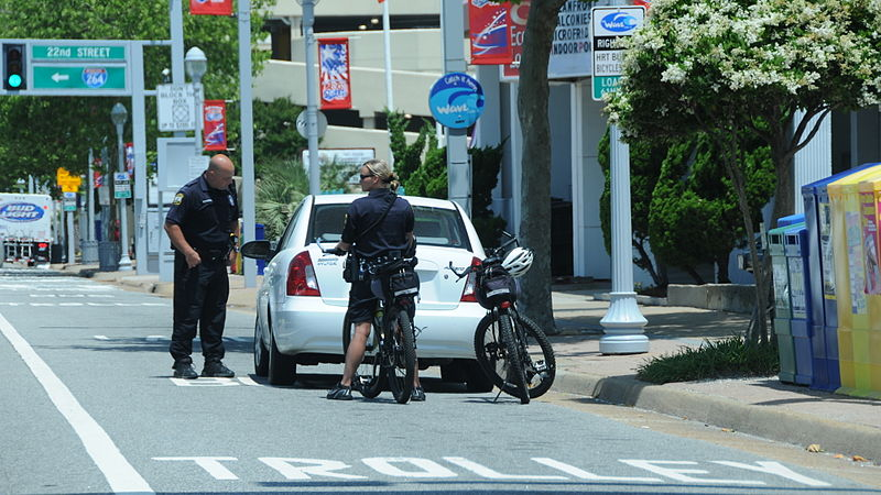 File:Cops on bicycle (4664478129).jpg