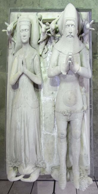 Margaret de Bohun, Countess of Devon - Effigies of Margaret de Bohun and her husband Hugh de Courtenay, 10th Earl of Devon, south transept, Exeter Cathedral. Two Bohun swans, the heraldic device of Bohun, are shown with their necks intertwined at Margaret's feet