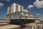 Crawler-transporter drives on resurrected Apollo-era crawlerway (KSC-00PP-0718).jpg