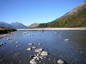 Cyclist crossing the Hurunui River.JPG